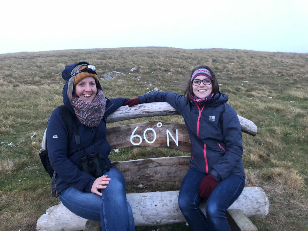 Sitting on the bench marking the 60 north latitude line on the island of Mousa, Shetland.