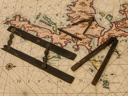 Navigating around unfamiliar Shetland waters was a challenge in the 18th century. This chart and navigation tools demonstrate what would have been available to the crew on the Queen of Sweden as she approached Shetland waters. Note the outline of hills on the chart - this was done so that the crew could recognise which part of the land they might be approaching from the shape of the hills. These items are all held in Shetland Museum & Archives. Photo: Davy Cooper.