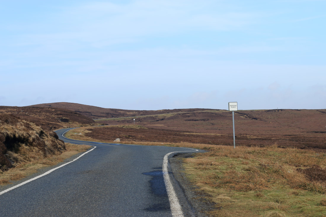 A Shetland passing place, man people visiting ask what
