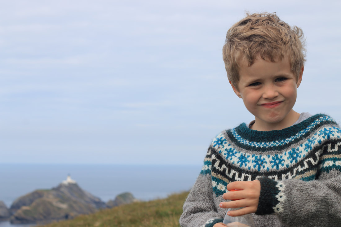Happy bairns: delighted to have made it to the UK's most northerly point; Muckle Flugga.