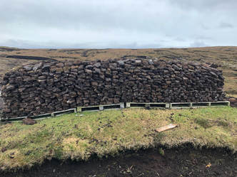 A traditional peat stack at Gunnister, Shetland.